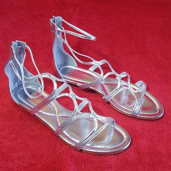 05e816f7bd48 Strappy Shiny Silver Flats Sandals NEW 8.5   9 CLN